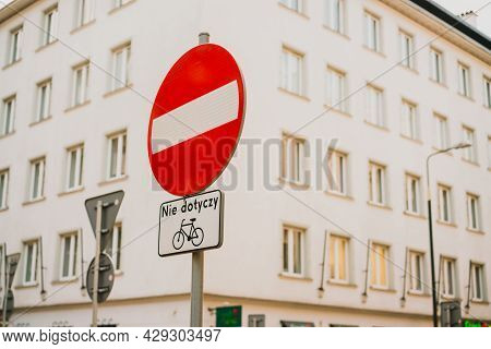 A Stop Sign Saying No Cycling In Polish. Bicycle. Nie Dotyczy. Restricted. Rules. Road. City. Street