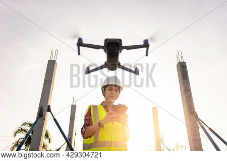Asian Woman Engineer Surveyor Control Drone For Aerial View Structure Inspection In Project Construc