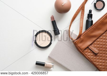 Cosmetic Pouch With Makeup Accessories On White Background. Flat Lay, Top View, Overhead.