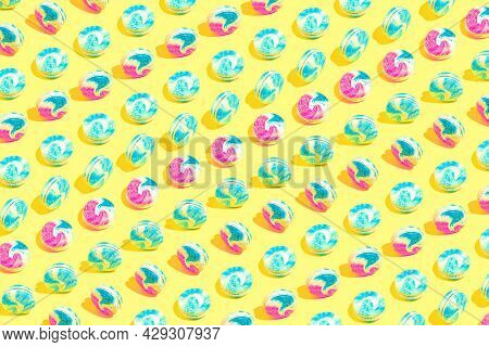 Creative Pattern Made Of Colorful Macaroons On Yellow Background. Dessert And Confectionary Concept.