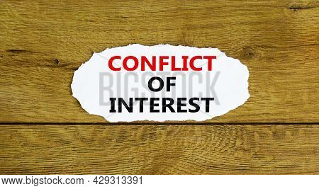 Conflict Of Interest Symbol. Words 'conflict Of Interest' On White Paper. Beautiful Wooden Backgroun