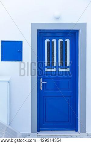 Blue door in Santorini. Greece