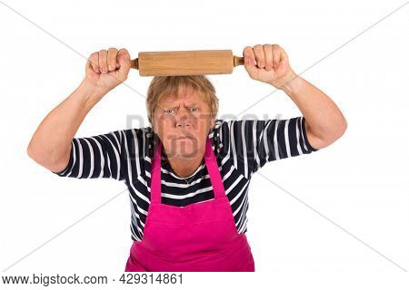 Very angry elder woman with pin roller isolated over white background