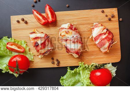 Baked Chicken Wrapped In Bacon. Delicious Appetizer With Crispy Smoked Bacon. Chicken Breast Wrapped