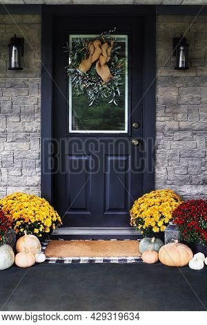 Front Porch Decorated For Thanksgiving Day With Homemade Wreath Hanging On Door. Heirloom Gourds,  W