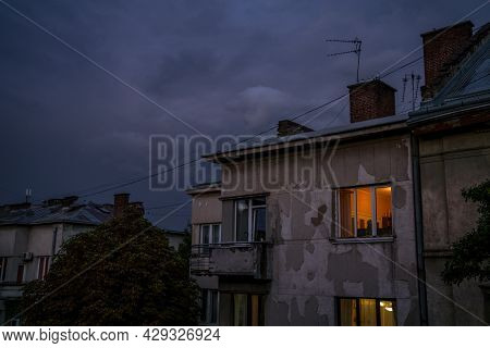 Poor Ghetto Living District Old Shabby Apartment Building With Illumination In Window In Evening Dus