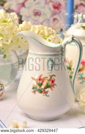 Antique Porcelain Creamer Close-up On The Table