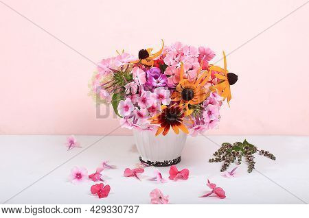 Colorful Flowers Of Rudbeckia And Phlox In A Vase Abstract Flower Arrangement, Autumn Background. Gr