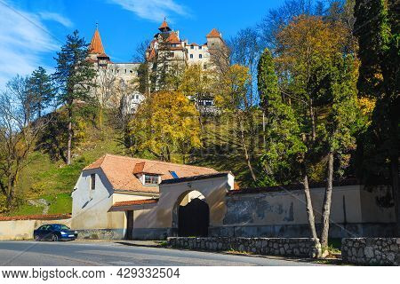 Picturesque Dracula Castle On The Hill And Autumn Scenery With Colorful Deciduous Trees, Bran, Trans