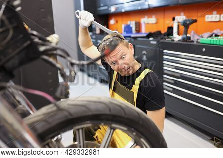 Pensive Apprentice Trainee Locksmith Thinks How To Fix Motorcycle