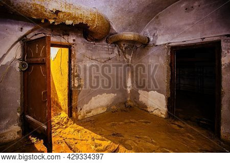 Old Abandoned Dirty Soviet Bunker, Echo Of Cold War.