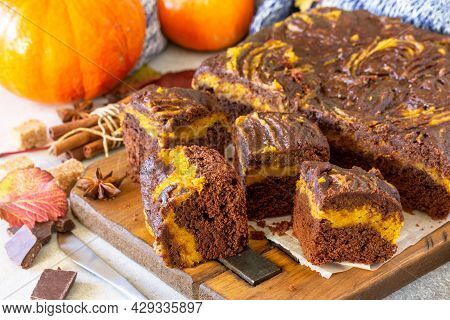 Thanksgiving Day Homemade Baking. Chocolate Brownie Pumpkin Puree Cake Dessert With Spices On A Ston
