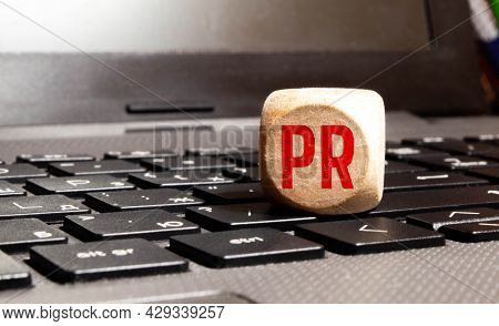 Pr, Public Relations Concept, Wooden Cube Block With Letters Forming Word Pr On White Gridline Noteb