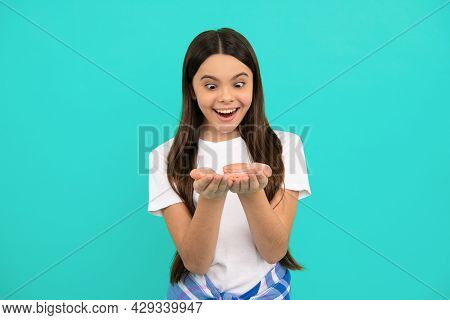 Amazed Teen Girl Hold French Macaron Or Macaroon Cookies, Confectionary