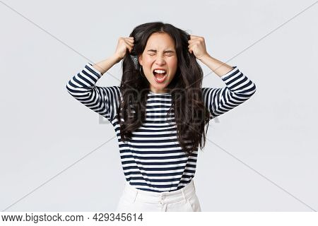Lifestyle, People Emotions And Casual Concept. Pissed-off Mad And Angry Asian Young Woman Tossing Ha