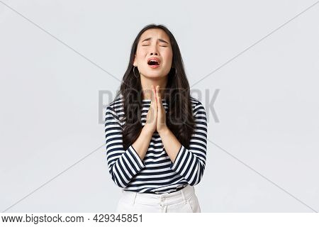 Lifestyle, People Emotions And Casual Concept. Desperate Hopeful Asian Girl Making Wish, Close Eyes