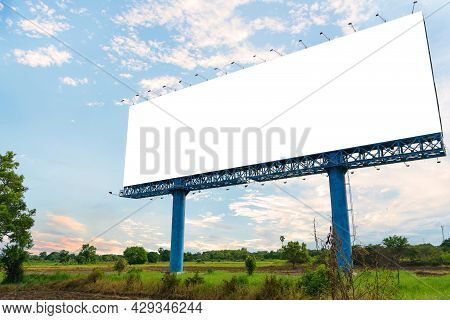 Billboard Blank For Advertising Poster Or Blank Billboard At Night Time For Advertisement On Road.