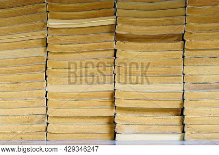 Pack Of Many Books Pile On Wooden Table At Library, Vintage Style.