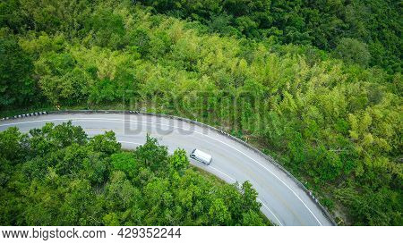 Aerial View Forest Nature With Car On The Road On The Mountain Green Tree Background, Top View Road