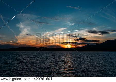 Beautiful Mountain Lake At Sunset. A Lake Among The Mountains At Sunset. Evening Landscape. Sunset S