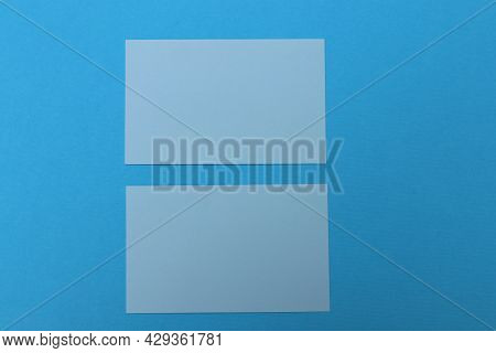 Two Light Blue Blank Paper Cards On Colorful Blue Background