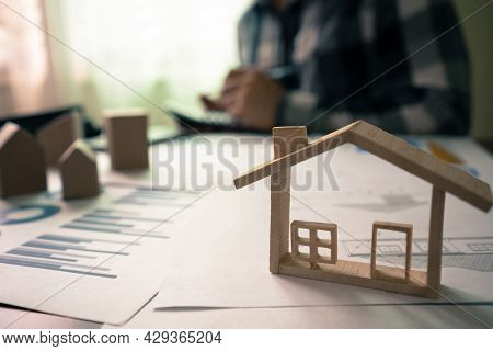 Concept For Real Estate, Moving To New Home Or Renting Property. Realtor House Agent Calculates The