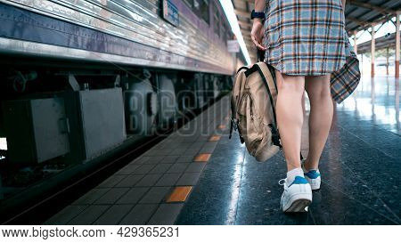 Young Girl Tourist Is Carrying A Bag And Walking On A Train To Travel. Background Travel And Vacatio