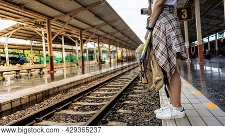 Young Girl Traveler Tourist Woman Carrying Backpack, Camera, Travel Map, Hat Walking And Waits For T