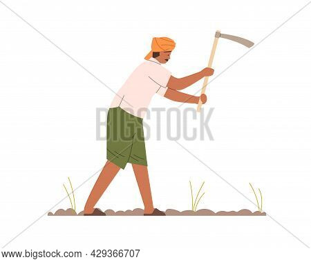 Indian Farmer Working With Hoe On Farm Field. Work Of Man In Turban On Plantation In India. Agricult