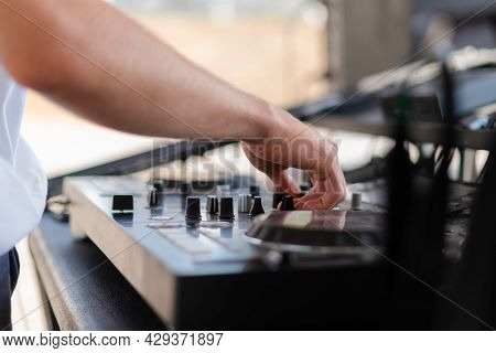 Dj Playing Music At Outdoor Event. Person Operating Mixer At Music Festival. Close Up Shot Of Deejay