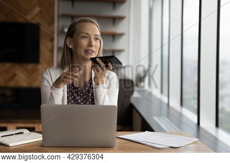Happy Business Woman Recording Audio Message On Cellphone