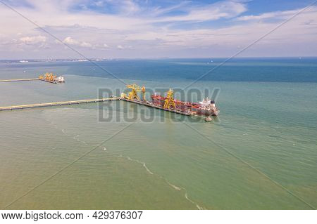 A Coal Transport Ship At The Dock Of The   Jimah Power Plant At The Malaysia West Coast. An Aerial V