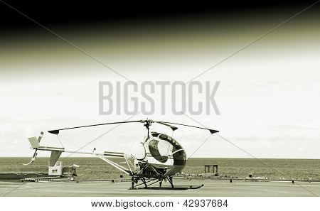 Small Helicopter On The Ground.