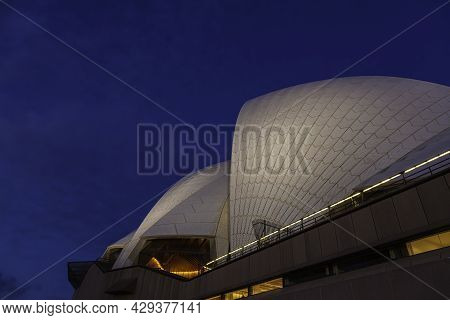 Sydney, Australia - October 14, 2020: The Roof Of The Illuminated Sydney Opera At Night. The Tiles O