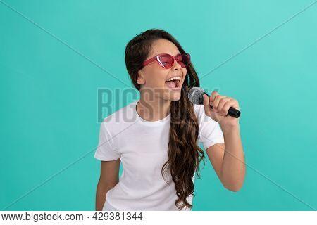 Have Fun At Karaoke. Karaoke Child Singer Blue Background. Happy Kid Sing Into Microphone. Music.