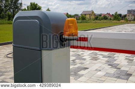 Close The Gate. Automatic Security System. Automatic Entry System. Yellow Light Signal With A Street