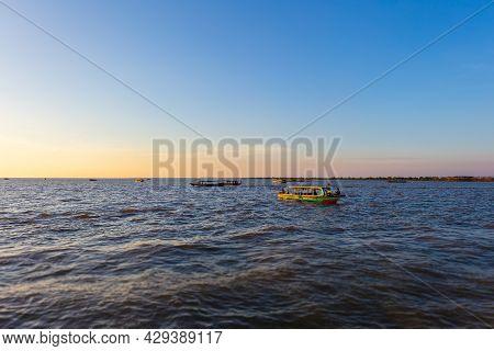 Sunset At Tonle Sap Lake, Cambodia, Near The Kampong Phluk Floating Village And Siem Reap. Tourism B