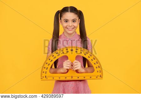 Happy Child Hold School Math Tool Protractor Ruler On Yellow Background, School