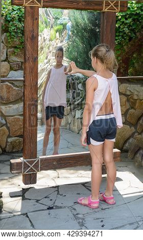Teen Girl In Front Of Distorting Mirror