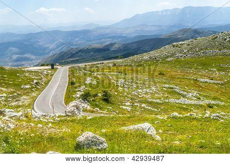 The road of Campo Imperatore (L'Aquila Abruzzi Italy) in the Gran Sasso d'Italia natural park. poster