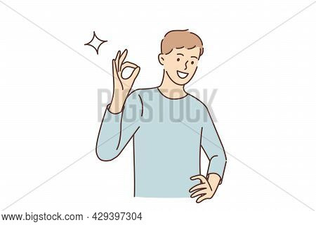 Ok Sign And Gesture Language Concept. Young Smiling Man Cartoon Character Standing Showing Ok Sign W