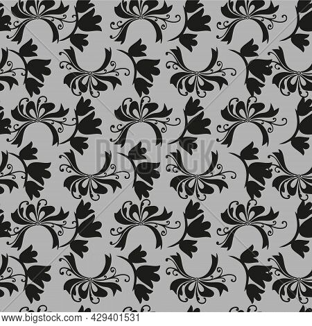 Seamless Beautiful Patern With A Pattern Of Leaves On A Gray Background