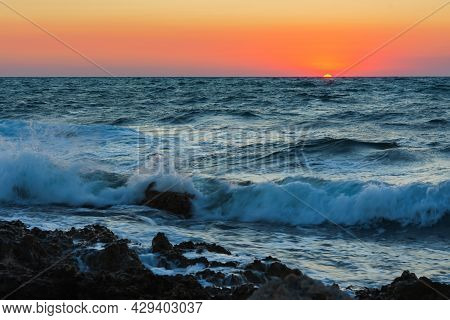 Sunset And Storm At Sea. Big Waves Against The Setting Sun. A Summer Storm In The Ocean. Beautiful S