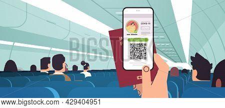 Passenger Hand Holding Digital Vaccinate Certificate And Global Immunity Passport In Airplane Corona