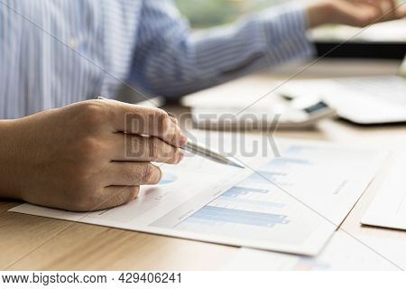 The Saleswoman Is Reviewing The Monthly Sales Summary Document Prepared To Bring To The Department M