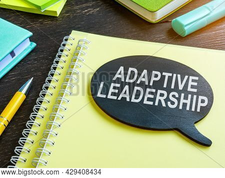 Adaptive Leadership Phrase On The Plate And Papers.