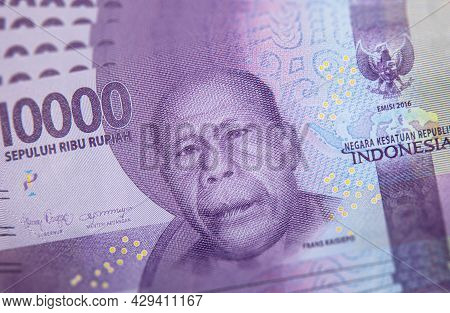 Close Up Of Indonesian Banknote.  Rupiah Is The Indonesian Currency. Here A Bunch Of 10000 Rupiah. T