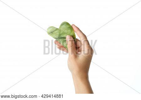 Female Hand Holds Gua Sha, Isolated On White Background