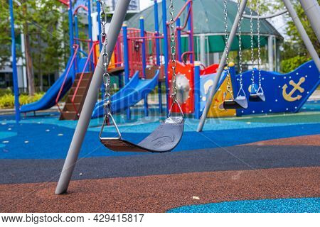 Abandoned Swing In A Playground. Playgrounds Are Blocked For Use In The Corona Lock Downs. Covid-19