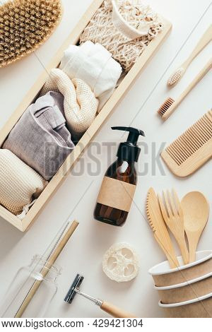 Zero Waste Eco-friendly Accessories Set. Flat Lay Amber Glass Dropper Bottle, Eco Bags, Wooden Toohb